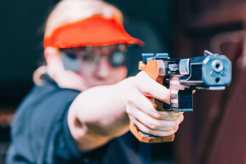 Sport Shooting Training. Woman Shooting Target Shooting Pistol Sport Shooting Gun Target Weapon Practicing Sports Training Training Female Woman Outdoor Barrel Competitive Sport Competition Protective Eyewear Handgun Concentration Technique Aiming Holding Serious Caucasian Ethnicity 30-39 Years Selective Focus