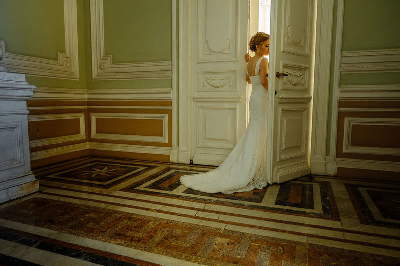 Adult Architecture Beautiful Woman Bride Door Dress Train Entrance Event Fashion Full Length Indoors  Lifestyles Newlywed One Person Real People Standing Wedding Wedding Ceremony Wedding Dress Wedding Dresses White Color Women Young Adult