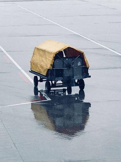Lonely Wet Rainy Day Luggage Cart  Airport Reflection Day Outdoors