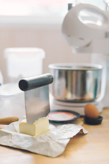 Cutting Homemade Bakery Butter Cheese Cutting Board Dairy Product Domestic Kitchen Domestic Room Food Freshness Home Homemade Bread Homemade Cake Household Equipment Indoors  Kitchen Kitchen Utensil Mixer Preparation  Preparing Food Selective Focus Still Life Table Wood - Material