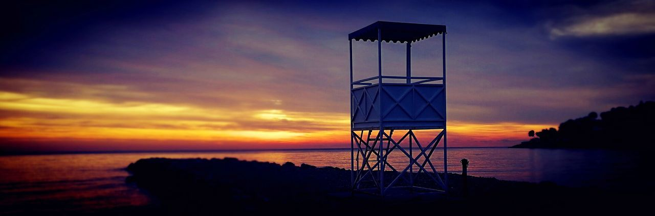 Sunset Sea Water Lifeguard Hut Horizon Over Water Built Structure Cloud - Sky Beach Sky Lifeguard  Safety Protection Silhouette Lookout Tower No People Beauty In Nature Scenics Architecture Nature Tranquility