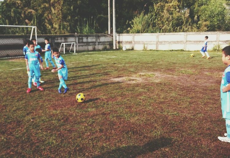 Football to basic on academy EyeEm Selects Football Wear Cup Winner Besic Playing Soccer Sport Childhood Soccer Field Boys Child Soccer Player Teamwork Full Length People Adult Outdoors Young Adult Sportsman Day Playing Field Competition Sports Team Nature
