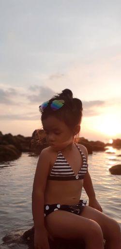 little thalassophile Photogenic  Sexy♡ Babygirl Little Wanderlust Thalassophile Pretty Girl 3yrolds Swimming Sea Women Human Back Sunset Water Beach Back Summer Females Swimwear Shore First Eyeem Photo