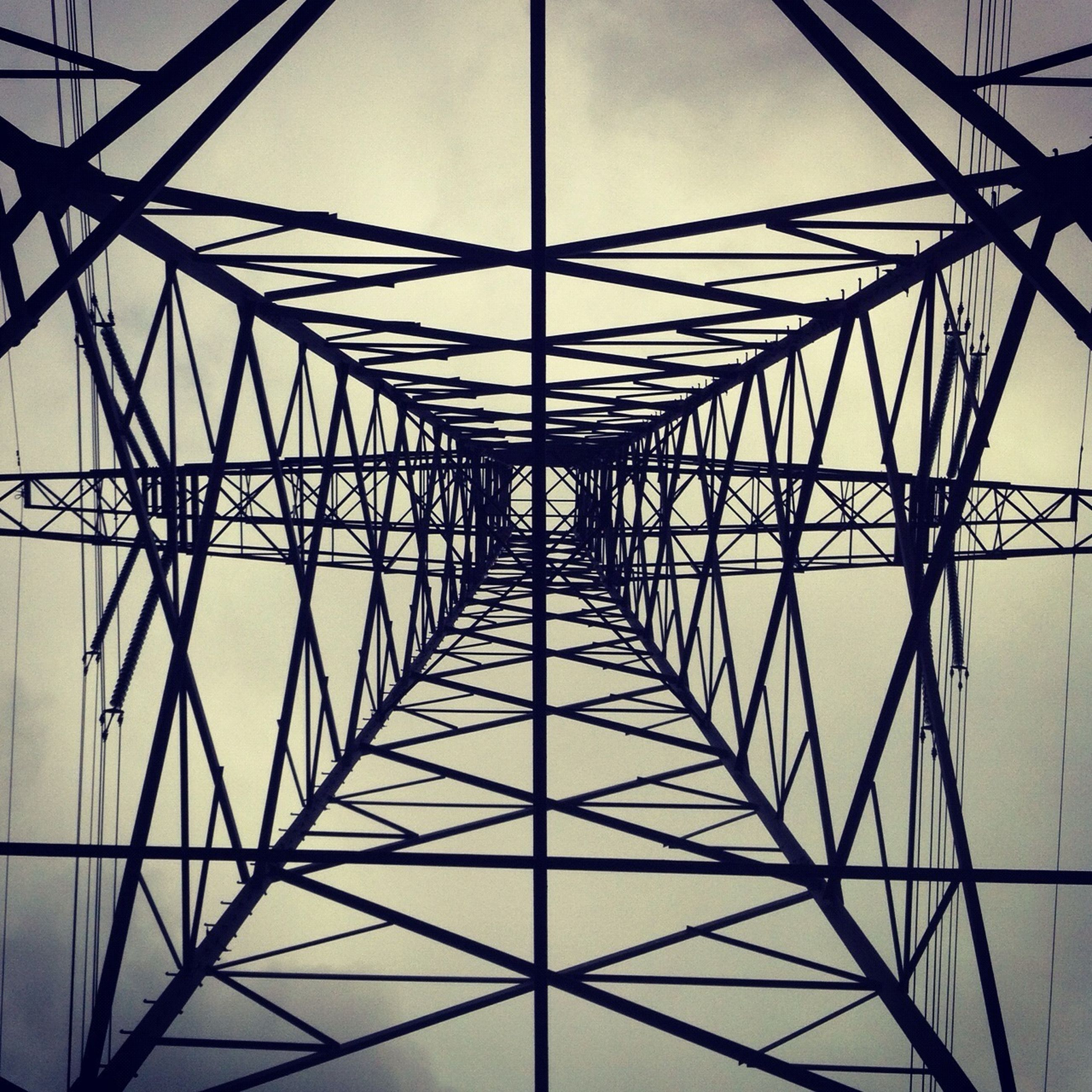 low angle view, connection, electricity pylon, power supply, power line, electricity, fuel and power generation, built structure, cable, metal, technology, sky, architecture, engineering, clear sky, no people, day, metallic, outdoors, directly below