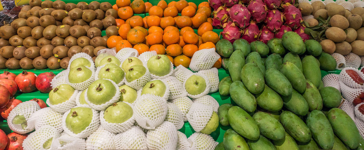 Fruits on display at a market Arrangement Backgrounds Choice Day Food Food And Drink For Sale Freshness Fruit Green Color Healthy Eating Large Group Of Objects Market Multi Colored No People Outdoors Retail  Variation