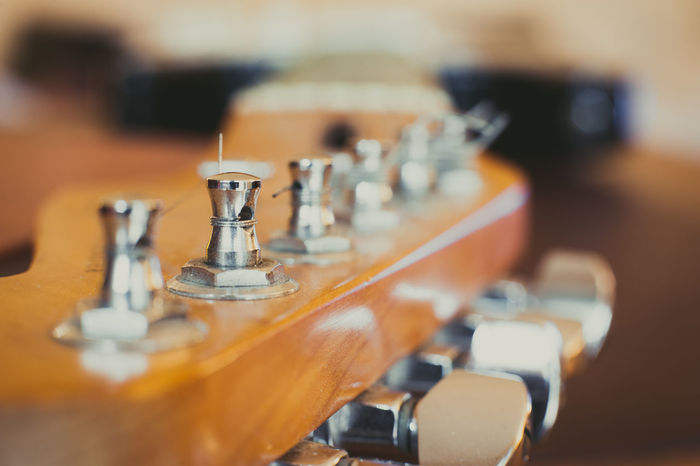 Electric guitar extreme close up Chords Close-up Electric Guitar Focus On Foreground Guitar Headstock In A Row Indoors  Man Made Object Music Musical Instrument No People Part Of Red Color Selective Focus Sound String Tuning Pegs