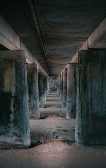 tunnel vision Architectural Column Built Structure Column Corridor Diminishing Perspective Empty In A Row Long Lowlight Lowtide  Melancholy Moody Narrow No People Sand The Way Forward Vanishing Point Walkway