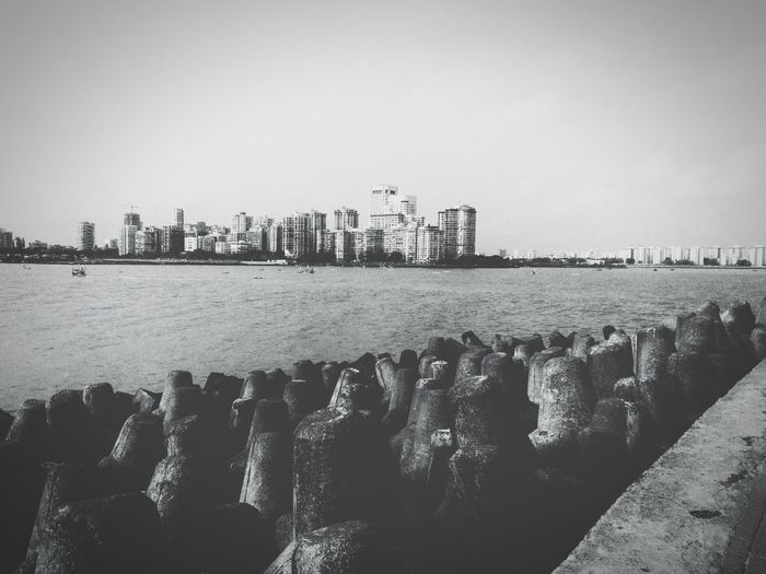 On the seafront Black & White Black And White Seafront Sea Facing City Cityscape Urban Skyline Water Skyscraper Apartment Sea Beach Politics And Government Residential Building Shore Coast Building Story Infrastructure Skyline City Location High Rise Standing Water Wide Shot Office Building Tall - High Tower The Great Outdoors - 2018 EyeEm Awards