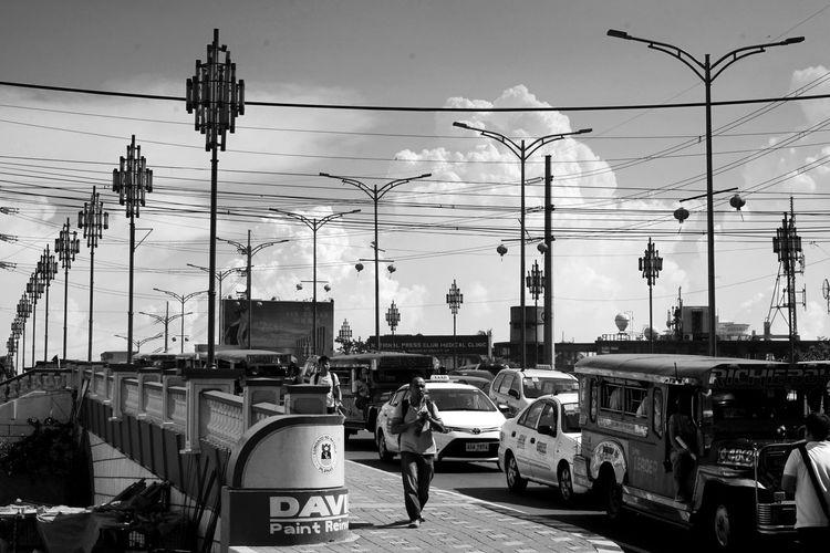 Street light in city against sky