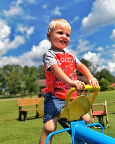 Childhood Child One Person Sky Children Only Casual Clothing Cloud - Sky Smiling Day Sitting People Boys Happiness Blond Hair Portrait Fun Leisure Activity One Boy Only Outdoors Summer