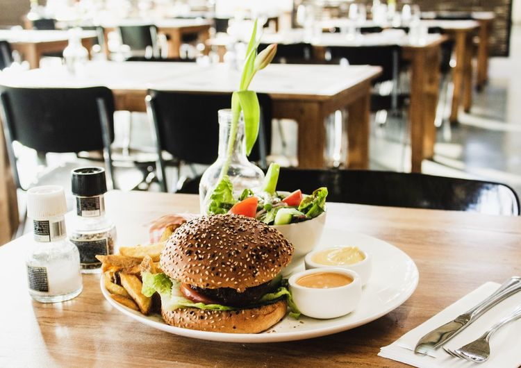 Food And Drink Food Table Burger Sandwich Freshness Ready-to-eat Hamburger Indoors  Fast Food Bread Unhealthy Eating Restaurant Vegetable Plate Drink Focus On Foreground Refreshment No People Glass Meal Bun Temptation
