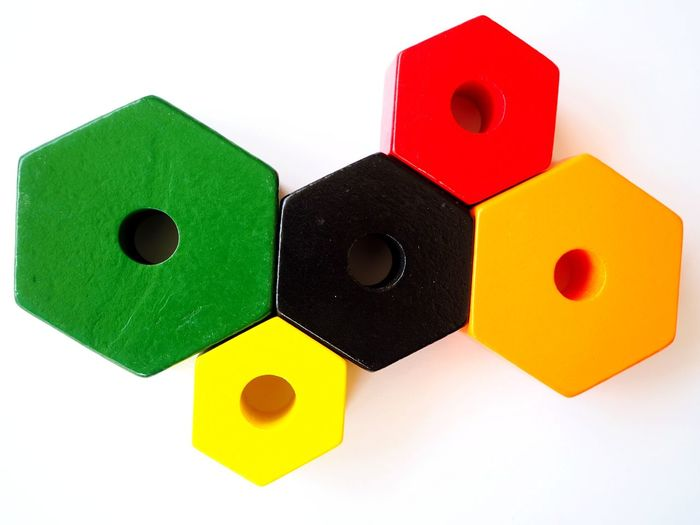 Multi Colored White Background Neon Life EyeEmNewHere Abstract Minimalism Minimalist Photography  Abstract Photography In A Row, Side By Side, Gears Geometric Background Wooden Shapes Geometry Geometric Shape Geometric Abstraction Geometry Pattern Colored Wood Hexagonstyle Hexagon Circles And Holes
