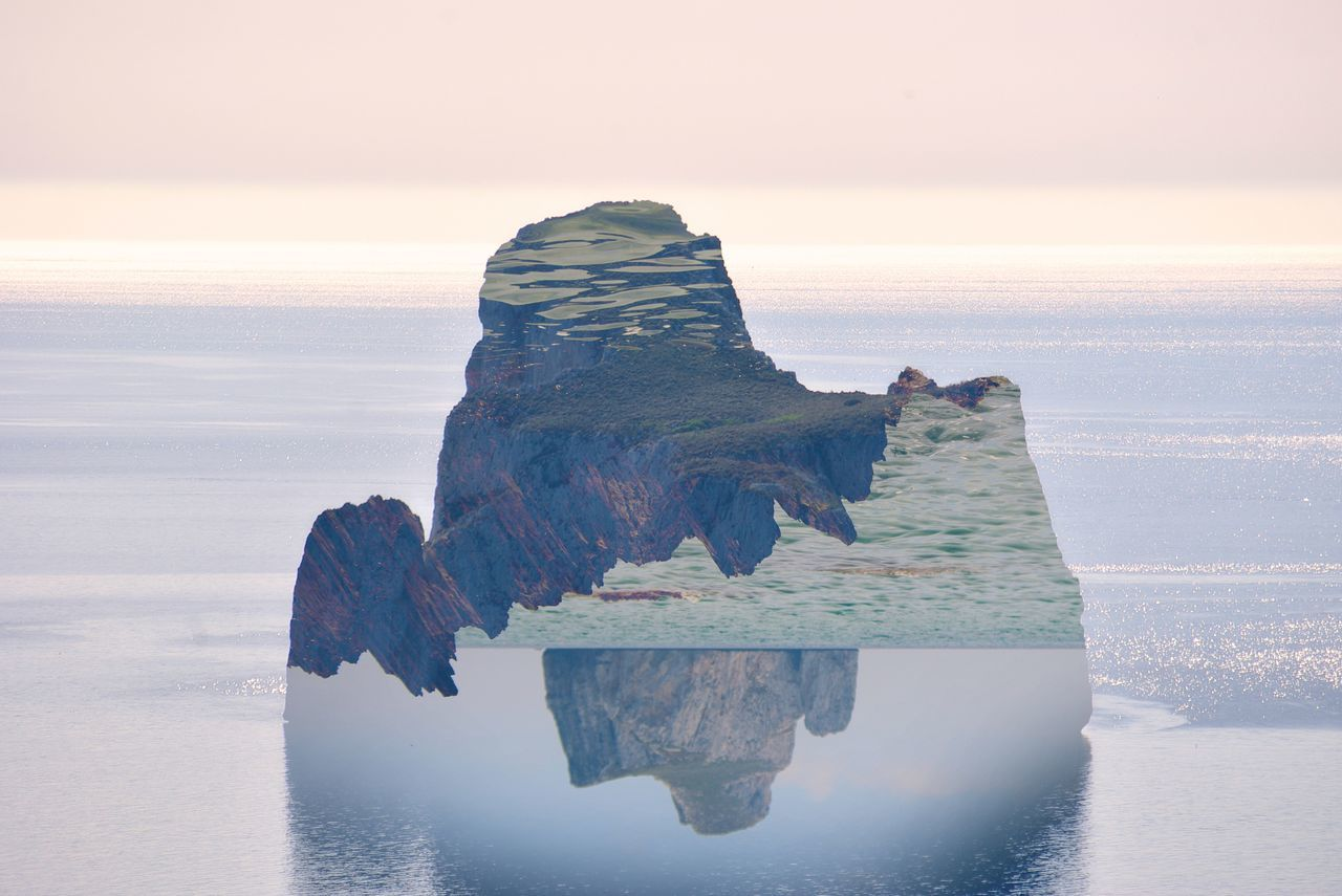 Digital composite image of rock formation in sea against sky during sunset
