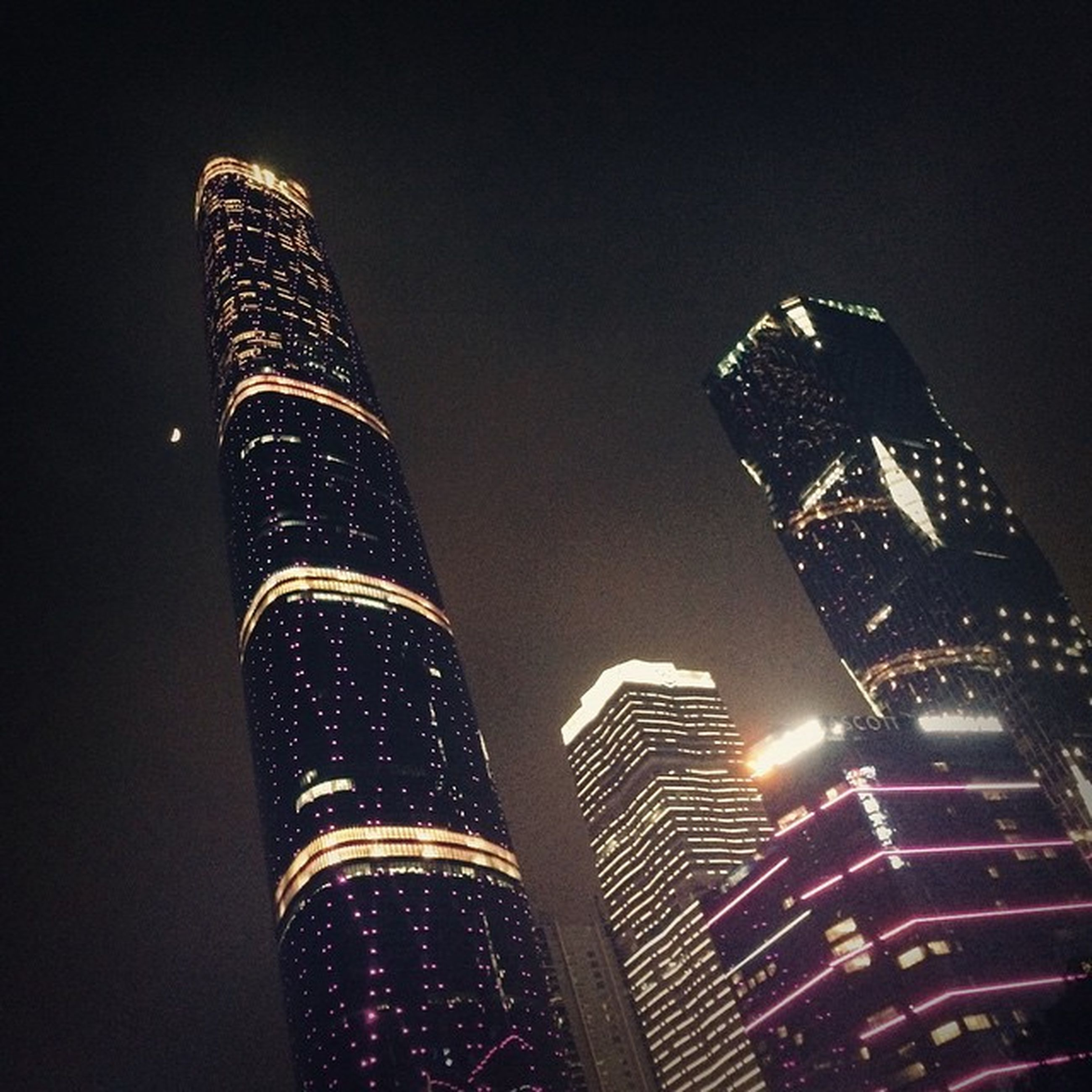 architecture, built structure, low angle view, building exterior, tall - high, night, tower, illuminated, skyscraper, city, modern, sky, travel destinations, famous place, office building, capital cities, tall, international landmark, no people, outdoors