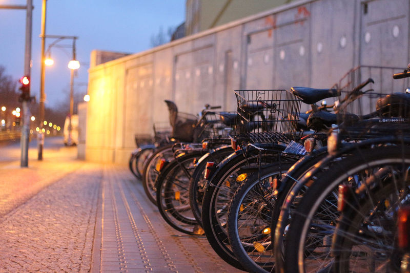 Bicycles On Street In City At Night