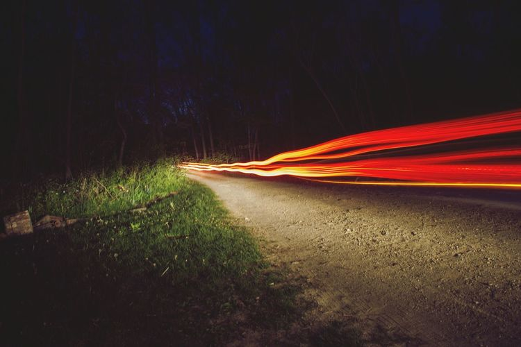 // Beams ☄☄ Night Long Exposure Light Trail Red Motion No People Outdoors Forest Road Nature Illuminated EyeEmNewHere Night Lights Lines Lightpainting Trails Red Car Cars