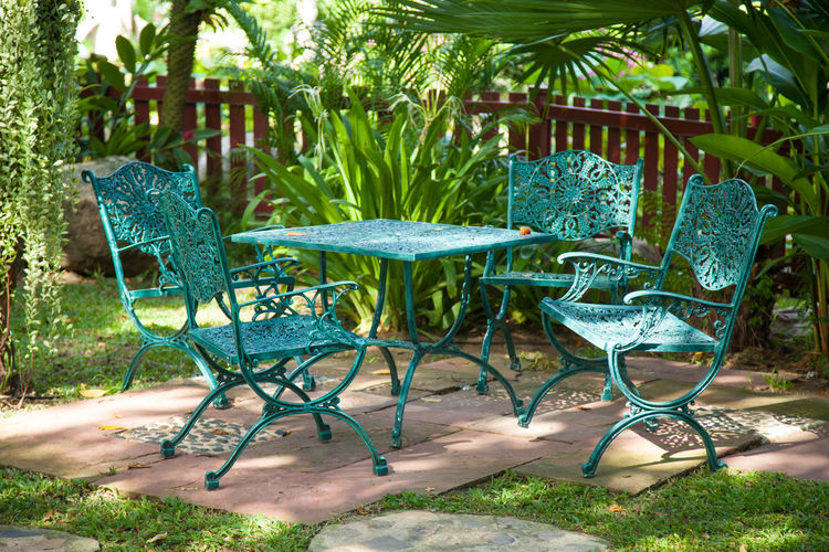 Chairs And Table Arranging In Yard