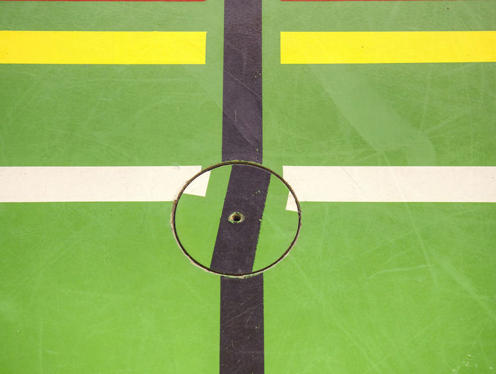 Close up to green colour court floor for training and tournament. modern surface of florball hall.