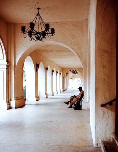 Woman sitting in corridor