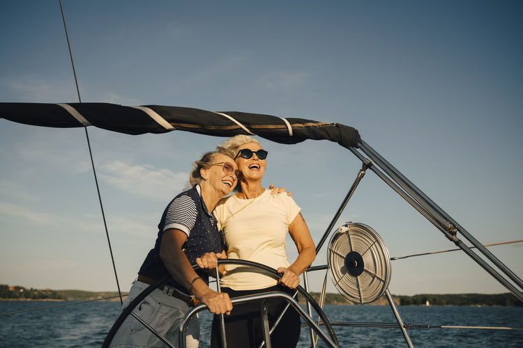 Young couple on boat against sky