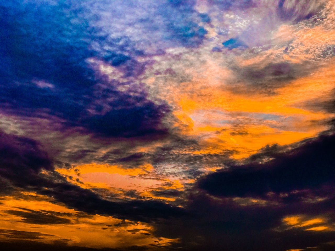 cloud - sky, sky, beauty in nature, scenics, nature, dramatic sky, orange color, tranquil scene, sunset, low angle view, tranquility, idyllic, no people, majestic, cloudscape, sky only, weather, outdoors, environment, abstract, backgrounds, multi colored, storm cloud, day
