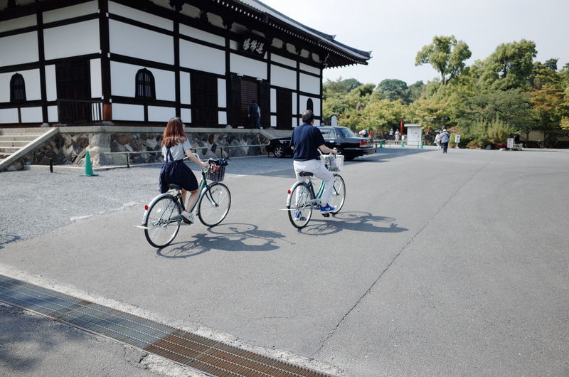 Architecture Bicycle Built Structure City City Life City Street Cycling Day Full Length Kyoto, Japan Land Vehicle Leisure Activity Lifestyles Mode Of Transport Outdoors Parked Parking Road Stationary Transportation