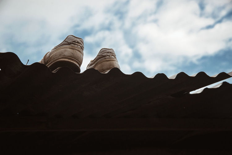 Shoes On A Rooftop Sneakers Sneakerhead  Low Angle View Sky Cloud - Sky No People Roof Architecture Nature Built Structure Day Outdoors Building Exterior Art And Craft Creativity Pattern Building Belief Solid Ornate Roof Tile Street Photography