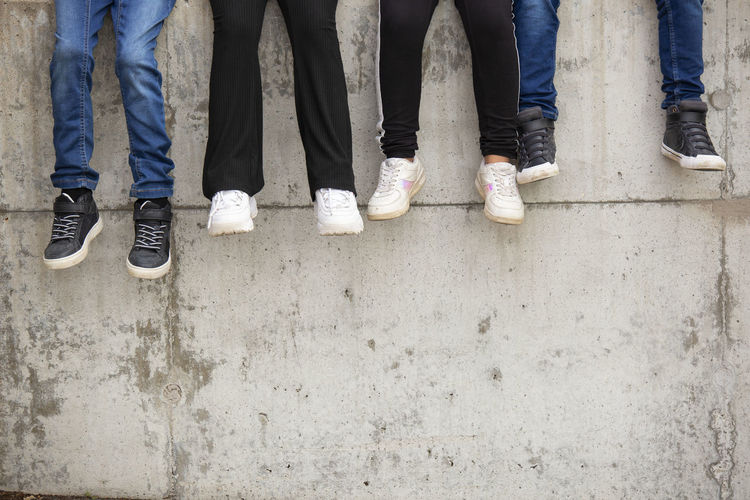 Low section of people standing on concrete floor