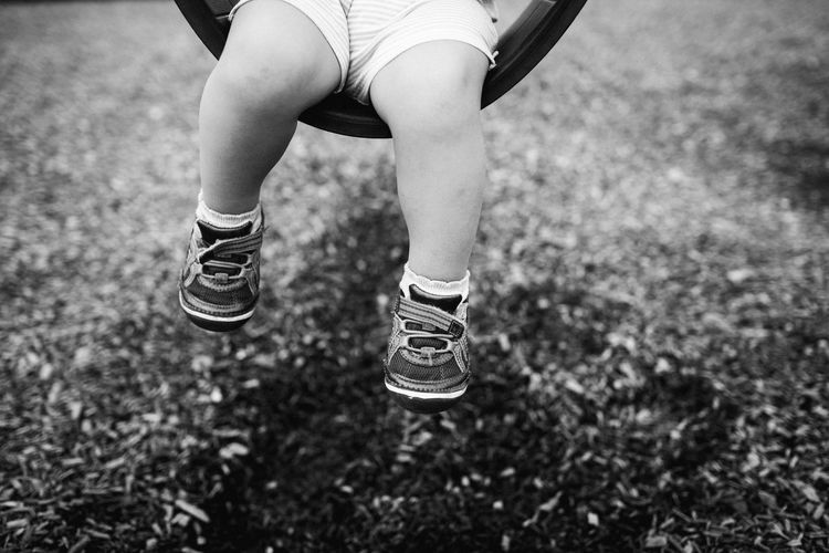 Baby legs on swing Authentic Moments Copy Space Leg Sitting Child Childhood Close-up Day Feet Focus On Foreground Human Body Part Human Leg Leisure Activity Lifestyles Low Section negative space One Person Outdoors People Real Life Real People Shoes Swing Toddler  Toddlerlife
