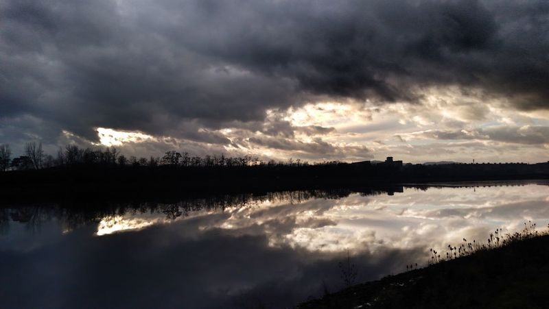 Water Tree Mountain Dawn Sunset Lake Reflection Silhouette Dark Reflection Lake Atmospheric Mood Dramatic Sky Cumulus Cloudscape Meteorology Dramatic Landscape Moody Sky Overcast