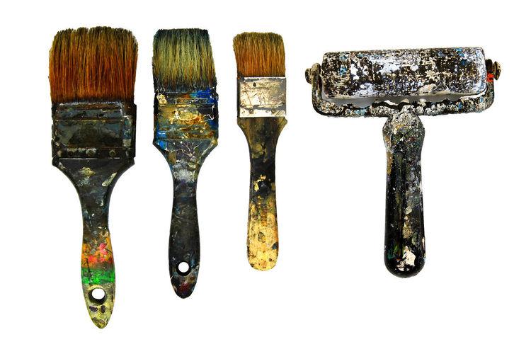 Close-up of paintbrushes against white background