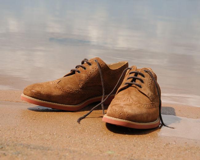 Pair of shoes at riverbank