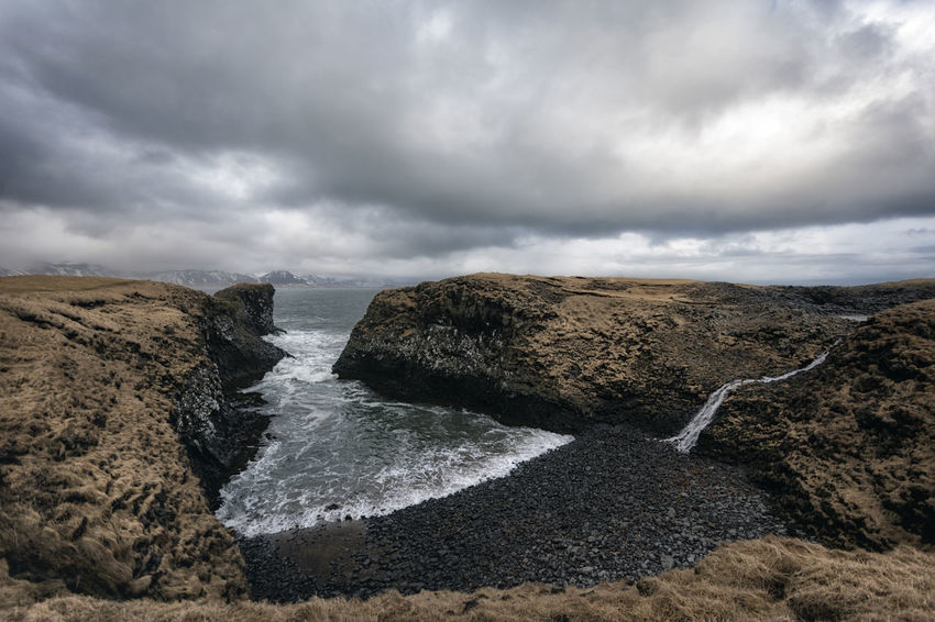 Landscape in Iceland Beauty In Nature Cloud Cloud - Sky Cloudy Coastline Day Geology Horizon Over Water Idyllic Nature Non-urban Scene Outdoors Overcast Remote Rock Rock - Object Rock Formation Scenics Sea Shore Sky Tranquil Scene Tranquility Water Weather