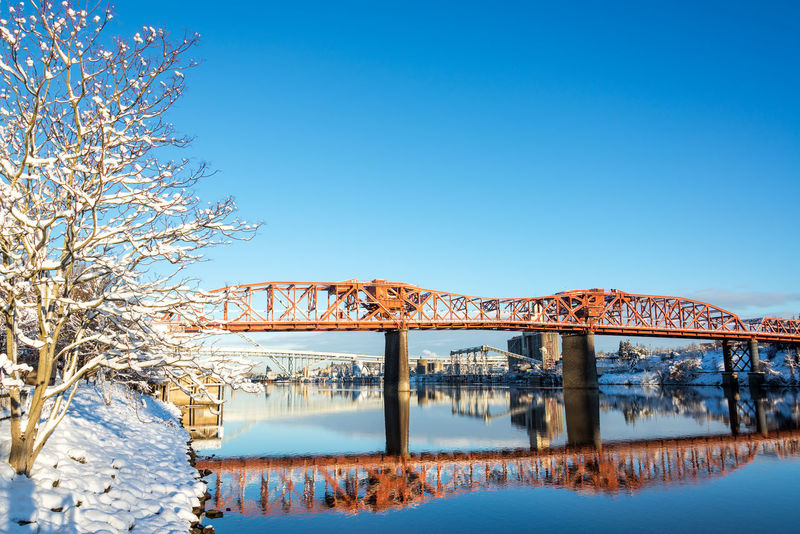 Broadway bridge reflection in winter in the Willamette River in Portland, Oregon Architecture Bridges Broadway Downtown Ice Mirror Oregon Pacific Portland Reflection Tree Trees Willamette River  Winter Bridge Cold Colorful Icy Northwest Old River Snow Town Waterfront White