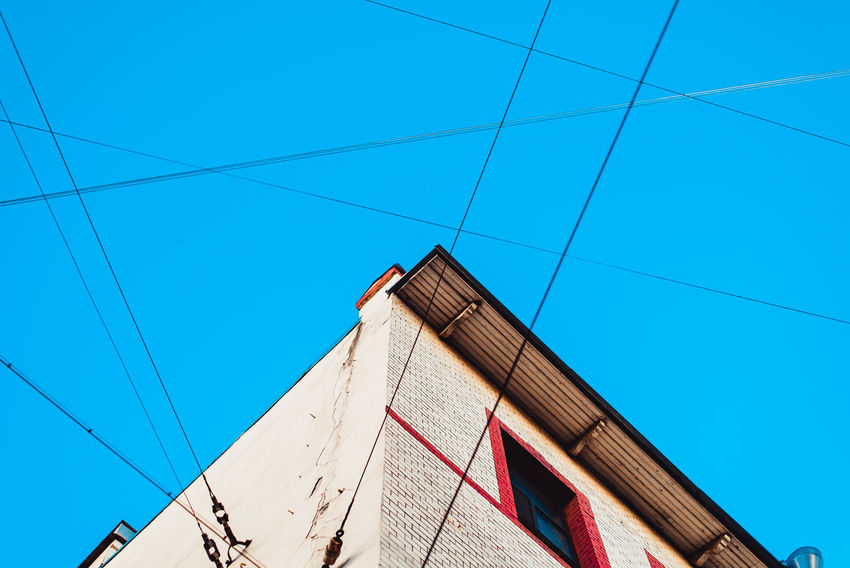 Power Line  Electricity  Built Structure Clear Sky Day Cable Sky Telephone Line Outdoors Blue Architecture Sunlight Cityscape Window SonyA7s Geometrical Shapes Urban Geometry First Eyeem Photo Adapted To The City The City Light
