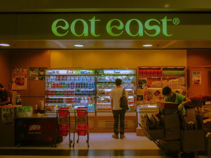 Let's east. Store Standing Text Retail  Communication Real People Customer  Full Length Business Indoors  Illuminated Men One Person Lifestyles Service Working Day Neon Food Supermarket . EyeEmNewHere Eye4photography  Eyeemphotography