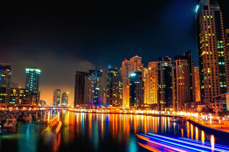 Illuminated Night Architecture Cityscape Building Exterior City Skyscraper Built Structure Travel Destinations Outdoors Urban Skyline Water Reflection Downtown District Waterfront Nightlife City Life No People Vacations Modern Be Ready Be. Ready. EeyEmnewhere Dubai Dubai Marina Mobility In Mega Cities