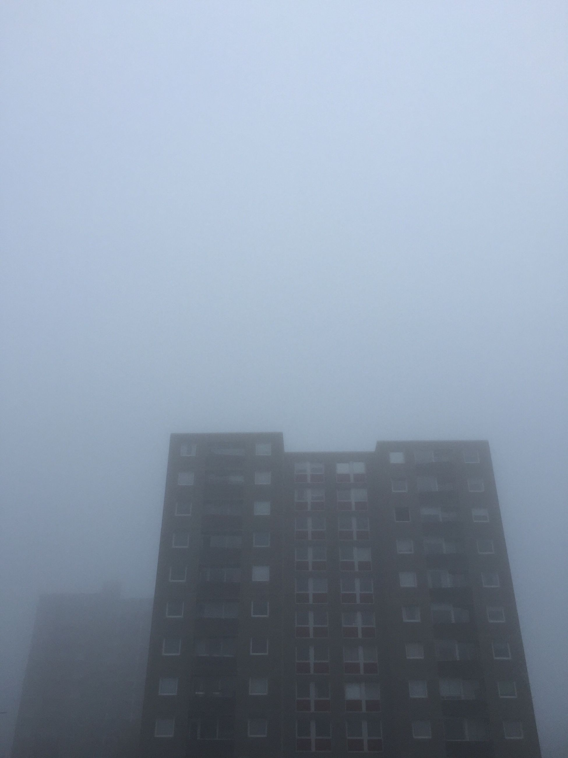 building exterior, architecture, built structure, fog, city, copy space, skyscraper, foggy, building, office building, tall - high, weather, modern, residential building, sky, residential structure, cityscape, day, no people