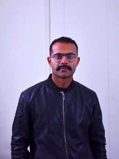 Why so serious! Beard Black Jacket Casual Clothing Confidence  Eyeglasses  Front View Handsome Jacket Lifestyles Mature Adult Mature Men Moustache Person Portrait Standing Stubble Tashan Warm Clothing Young Adult Young Men
