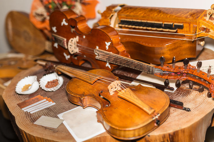 High angle view of violin on wooden table