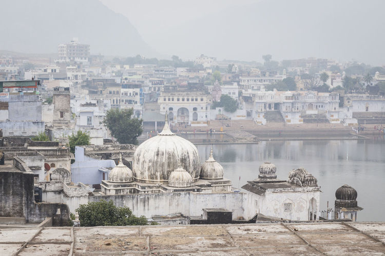 scene of Pushkar town and Pushkar lake in winter season, Rajasthan, India Architecture Building Exterior Built Structure City Cityscape Day Dome Holycity India Indiapictures Outdoors Pushkar Residential District Tourism Travel Destinations Wintertime