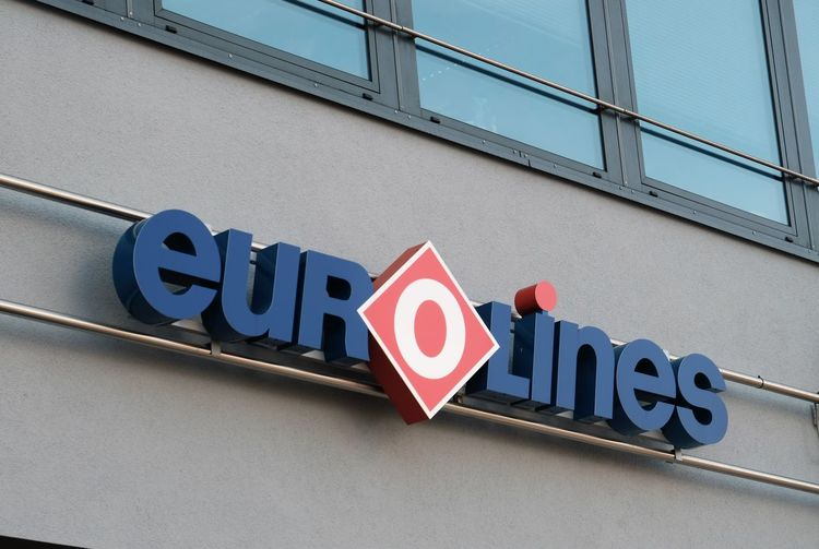 Berlin, Germany - August 17, 2017: Eurolines signage. The Belgian company operates a transnational network, connecting 600 destinations Company Eurolines Logo Long Distance  Signage Transport Transportation Travel Traveling Travelling Arrival Building Exterior Close-up Connecting Departure Editorial  Network No People Outdoors Signboard Symbol Terminal Text Tourism Western Script