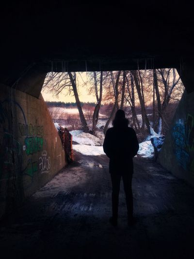Tunnel Tunnel Vision Tunnel View In The Tunnel darkness and light Dark Light And Shadow Trees Sky Orange Sky Snow Snow ❄ Winter Wintertime Man Standing Graffiti Graffiti Wall Graffitiwall Hungary Full Length Window Standing