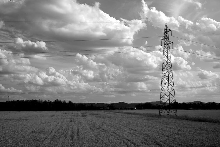 Cloud - Sky Agriculture Field Rural Scene Sky Electricity  Landscape Outdoors Cable No People Day Storm Cloud Technology Electricity Pylon Tree Nature Grass Fuji Xt1 Fujixt1 Fujifilm_xseries Fuji X-T1 Fuji Black And White Beauty In Nature Thunderstorm
