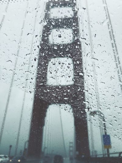Close-up of wet car window during rainy season