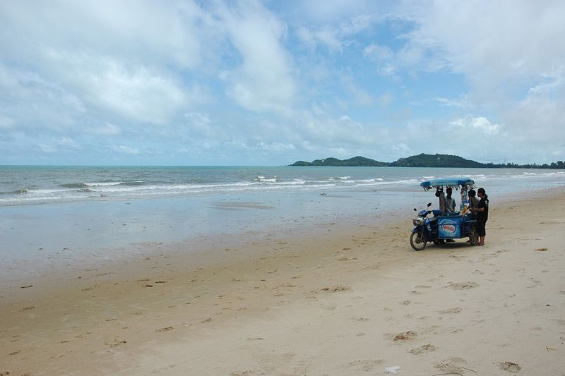 Ice cream motorcycle on beach Beach Transportation Sand Sea Water Sky Car Cloud Day Occupation Motorcycle Ice Cream People Trade
