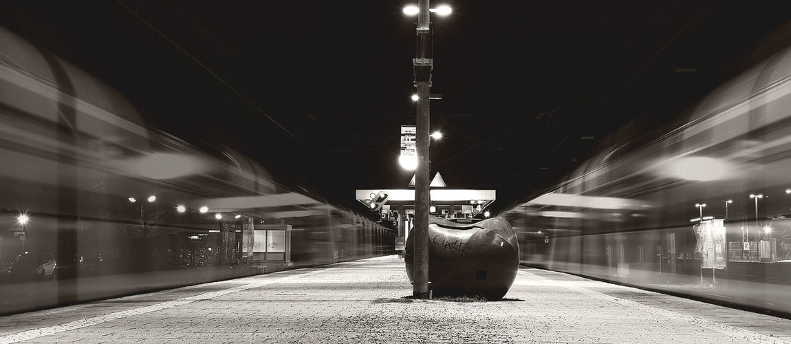 Architectural Column Architecture Black And White Built Structure Diminishing Perspective Electric Light Empty Illuminated Lighting Equipment Lit Long Monochrome Night No People The Way Forward Train Train Station Travel Vanishing Point Waiting For A Train
