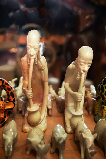 Close-up of statues on table at store
