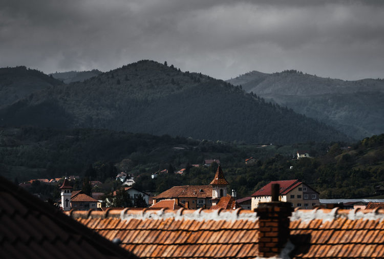 Back Home Architecture Mountain Built Structure Roof Building Exterior Building Residential District Cloud - Sky Sky House Nature Mountain Range No People Day Roof Tile Town City High Angle View Environment Outdoors TOWNSCAPE Sibiu Romania EyeEm Best Shots EyeEmNewHere EyeEm Selects EyeEm Nature Lover EyeEm Gallery Nikon D7500 Cisnadie Medieval Old Architecture Mood