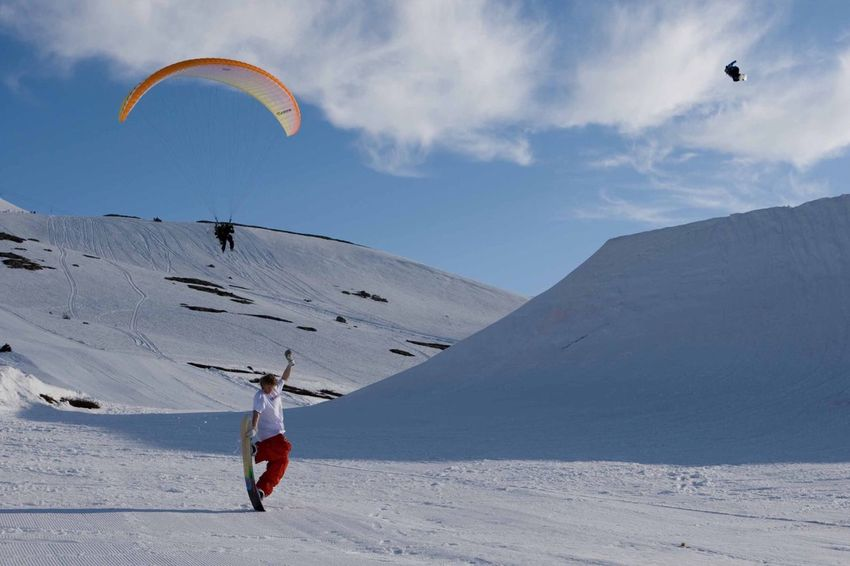 Snow Sports Snowboarding, Paragliding and Filming on the same slopes...Mikkel Bang with a flatland maneuver, Mads Jonsson airs the hip jump while Greg Martin is flown around capturing motion footage, GoodTimes ! Norway Snowboarding Mountains Fun Springtime Paragliding